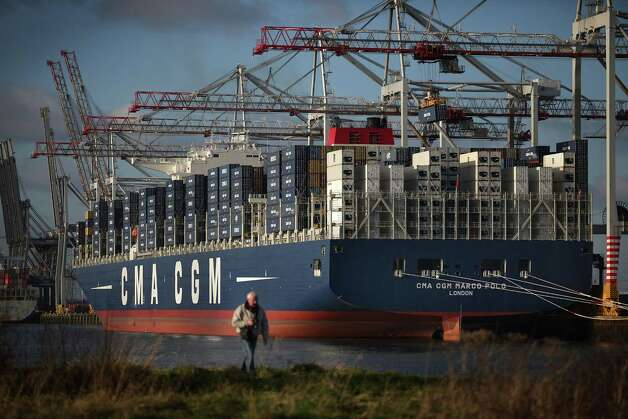 A man walks near the Marco Polo, the world's biggest container ship, at Southampton docks on December 10, 2012 in England, during the ship's first visit to Europe. The Marco Polo is 177 feet wide and 1,299 feet long. Photo: Peter Macdiarmid, Getty Images / 2012 Getty Images