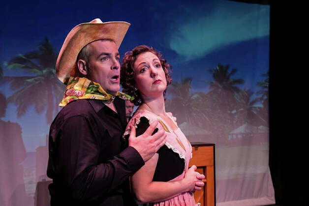 "Left to right in ""The Musical of Musicals (The Musical!)"" are Tom Denihan and Jessica Smith in the  vignette ""Corn!"" The number is a parody in the style of Rodgers and Hammerstein. This zany show runs through Jan. 5 at TheatreWorks New Milford. Photo: Contributed Photo"