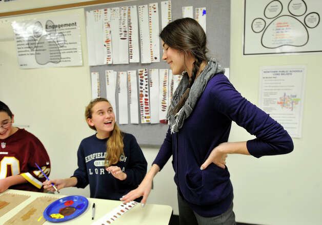 Meaghan Lynn, left, and seventh-grade art teacher Ellen Diker converse during class at Newtown Middle School on Monday, Dec. 10, 2012. The state Department of Education recently released an index of top schools and Newtown Middle School ranked high on the list in the Danbury area. Photo: Jason Rearick / The News-Times
