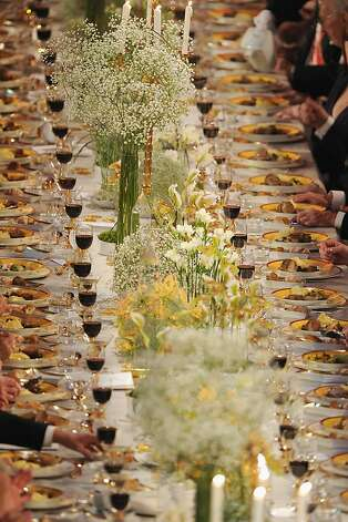 STOCKHOLM, SWEDEN - DECEMBER 10:  A view of the plates of food and glasses of wine on one of the tables at the Nobel Banquet after the 2012 Nobel Prize Ceremony at Town Hall on December 10, 2012 in Stockholm, Sweden. The European Union has collected this year's prestigious Nobel Peace Prize for uniting the continent after two World Wars, during a ceremony held in Oslo, Norway. Photo: Pascal Le Segretain, Getty Images