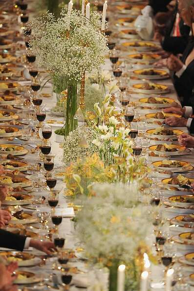 STOCKHOLM, SWEDEN - DECEMBER 10:  A view of the plates of food and glasses of wine on one of the tab
