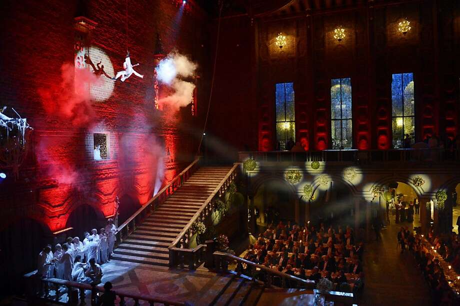 Circus artists from 'Cirkus Cirkoer' entertain during the Nobel banquet in 'The Blue Hall' at the Stockholm City Hall, Monday Dec, 10, 2012. Photo: Jessica Gow, Associated Press