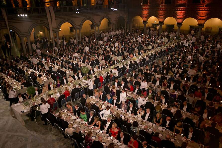 Guests are served dessert during the 2012 Nobel Prize Banquet at the Town Hall in Stockholm, Monday,