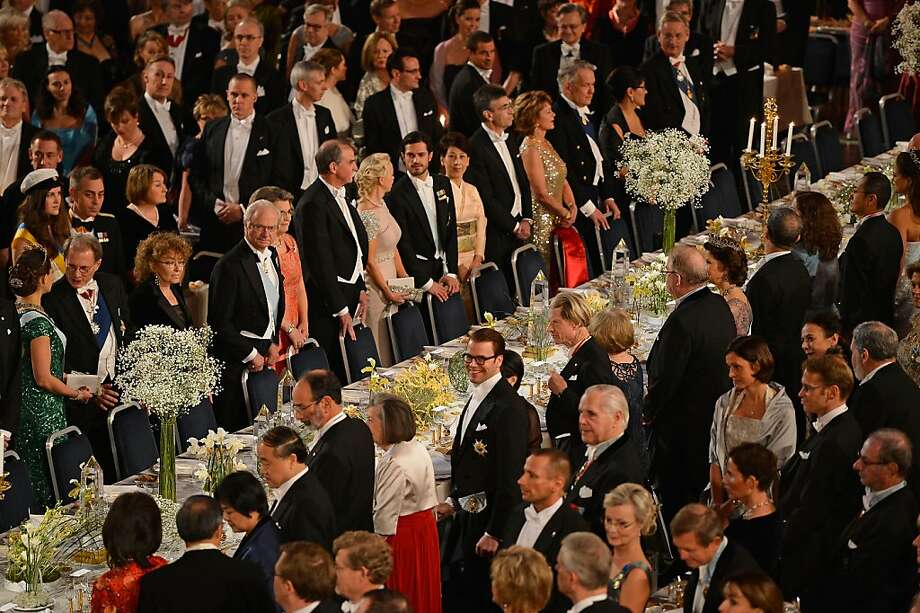 STOCKHOLM, SWEDEN - DECEMBER 10:  Crown Princess Victoria of Sweden (L) and King Carl XVI Gustaf of Sweden (4th L) attend the Nobel Banquet at Town Hall on December 10, 2012 in Stockholm, Sweden. The European Union has collected this year's prestigious Nobel Peace Prize for uniting the continent after two World Wars, during a ceremony held in Oslo, Norway. Photo: Pascal Le Segretain, Getty Images