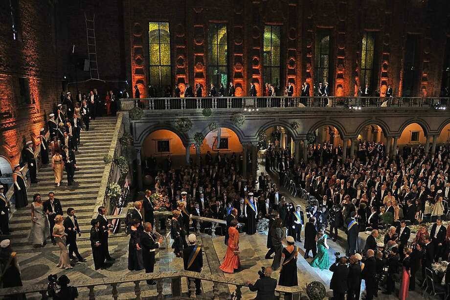 STOCKHOLM, SWEDEN - DECEMBER 10:  Members of the Royal family, with Crown Princess Victoria of Sweden (in green evening dress at bottom right) and Nobel Prize laureates walk down the stairs as they arrive for Nobel Banquet at Town Hall on December 10, 2012 in Stockholm, Sweden. The European Union has collected this year's prestigious Nobel Peace Prize for uniting the continent after two World Wars, during a ceremony held in Oslo, Norway. Photo: Pascal Le Segretain, Getty Images
