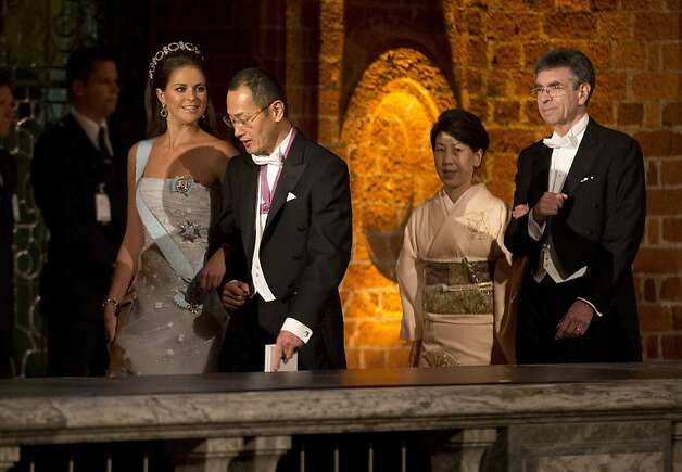 The 2012 Nobel Prize Laureate for Physiology or Medicine Japan's Shinya Yamanaka, second left, walks with Sweden's Princess Madeleine, left, in front of his wife Chika, third left, and the 2012 Nobel Prize Laureate for Chemistry Robert J. Lefkowitz, right, from the U.S. as they arrive for the 2012 Nobel Prize Banquet at the Town Hall in Stockholm, Monday, Dec. 10, 2012. Photo: Matt Dunham, Associated Press