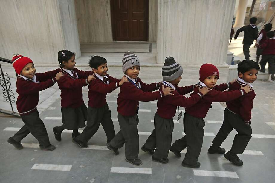 That's our queue:Indian pupils conga to class after morning assembly at the Central Baptist Church School in New Delhi. Photo: Kevin Frayer, Associated Press