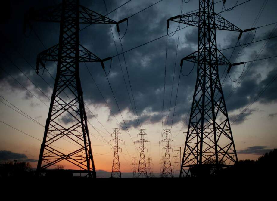 Electric power reserves are expected to be below targeted levels next summer, which means there is a risk of rolling blackouts at peak power usage times, according to a report by the Electric Reliability Council of Texas. Photo: Allison V. Smith, The New York Times / NYTNS