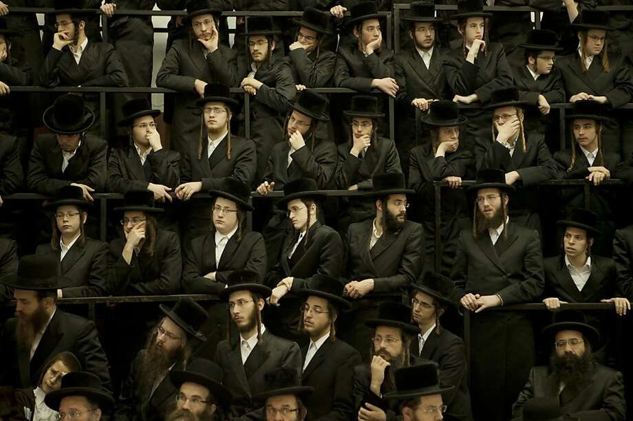 Ultra Orthodox Jewish men sit during a celebration of the Jewish holiday of Hanukkah in Bnei Brak, near Tel Aviv, Israel, Monday, Dec. 10, 2012. (AP Photo/Dan Balilty) Photo: Dan Balilty, Associated Press