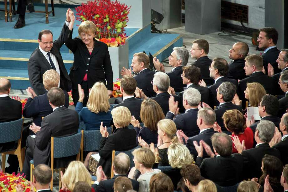 German Chancellor  Angela Merkel and French President Francois Hollande celebrate the EU's Nobel Peace Prize honor. Photo: Pool, Getty Images / 2012 Getty Images