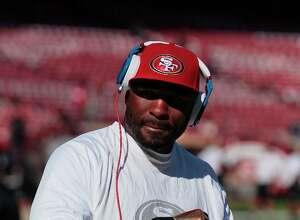 "In this Nov. 11, 2012, photo, San Francisco 49ers running back Brandon Jacobs warms up before an NFL football game against the St. Louis Rams in San Francisco. Jacobs has posted advice on Twitter with a reference to never working ""in a place where you hate your boss so much.""  The hash tag: ""YouLiveAndYouLearn."" Jacobs had terrible timing with the tweet Thursday afternoon, considering San Francisco coach Jim Harbaugh was hospitalized for what the team called a ""minor procedure"" for an irregular heartbeat. In the locker room soon after his post, Jacobs said people shouldn't ""assume"" his remarks were football-related, then followed up with more tweets. He made one post saying that ""football is not my life."" (AP Photo/Jeff Chiu)"
