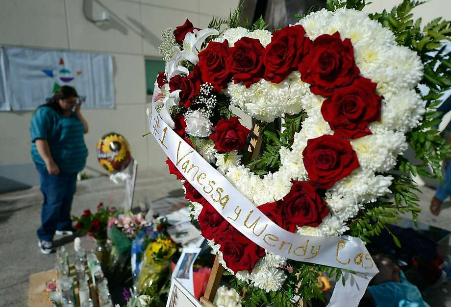 Items are displayed at a makeshift memorial for Mexican-American singer Jenni Rivera at a Mexican radio station that is playing her songs continuously all day on December 10, 2012 in Burbank, California. US authorities confirmed  that  Rivera, a U.S.-born singer, was killed in a plane crash in rugged territory in Nuevo Leon state in northern Mexico upon impact.  (Photo by Kevork Djansezian/Getty Images) Photo: Kevork Djansezian, Getty Images