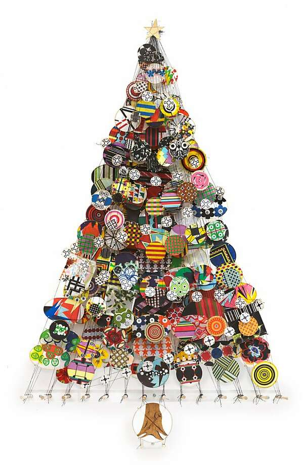 Albero is the name of Jacob Hashimoto's die-cut, vinyl Christmas tree wall decal.