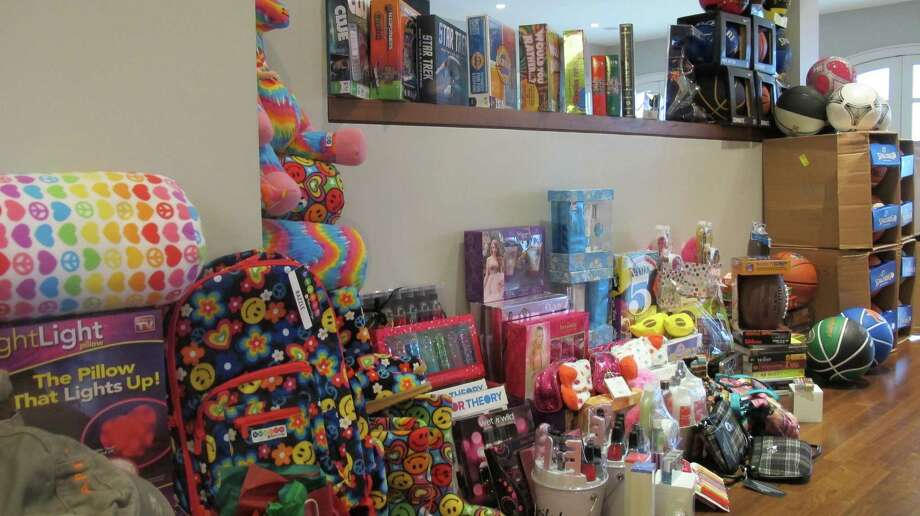 Gifts for Staten Island teens whose homes were devastated by Hurricane Sandy line a wall in a the Westport home. A group of Westporters through Saturday, Dec. 15, is collecting gifts for youths ages 12 to 17. Photo: Contributed Photo / Westport News contributed