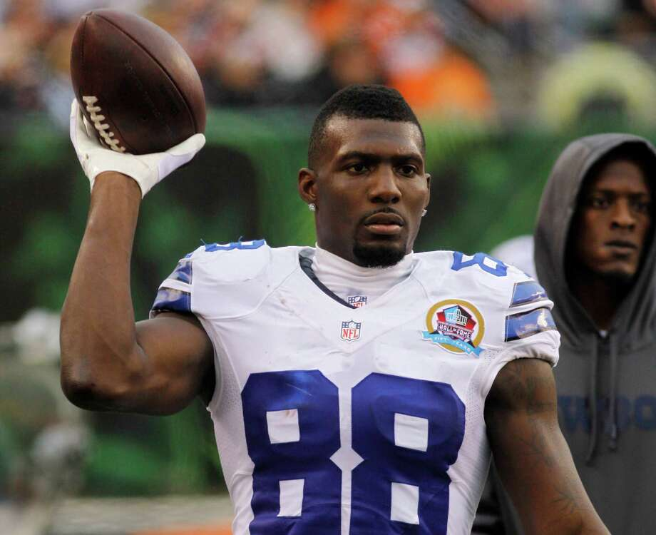 Dallas Cowboys wide receiver Dez Bryant tosses a football on the sidelines in the second half of an NFL football game against the Cincinnati Bengals, Sunday, Dec. 9, 2012, in Cincinnati. (AP Photo/Tom Uhlman) Photo: Tom Uhlman, Associated Press / FR31154 AP