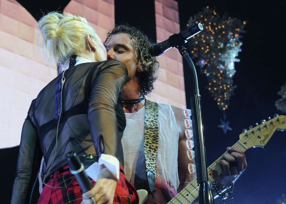 Gwen Stefani gives husband Gavin Rossdale a kiss as she performs with Bush at KROQ Almost Acoustic Christmas on Saturday, Dec. 8, 2012, in Los Angeles. Photo: Katy Winn, Katy Winn/Invision/AP / Invision2012