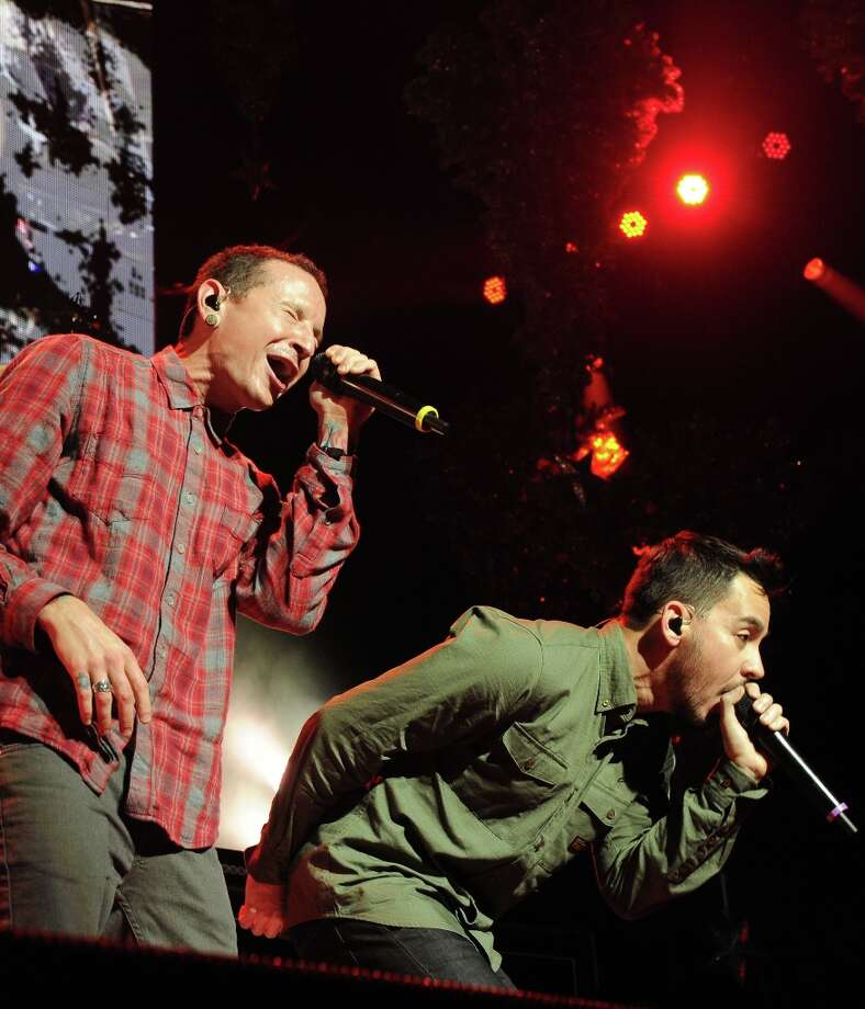 Chester Bennington, at left, and Mike Shinoda, of Linkin Park perform at KROQ Almost Acoustic Christmas on Saturday, Dec. 8, 2012, in Los Angeles.  (Katy Winn/Invision/AP) Photo: Katy Winn, Associated Press / Invision