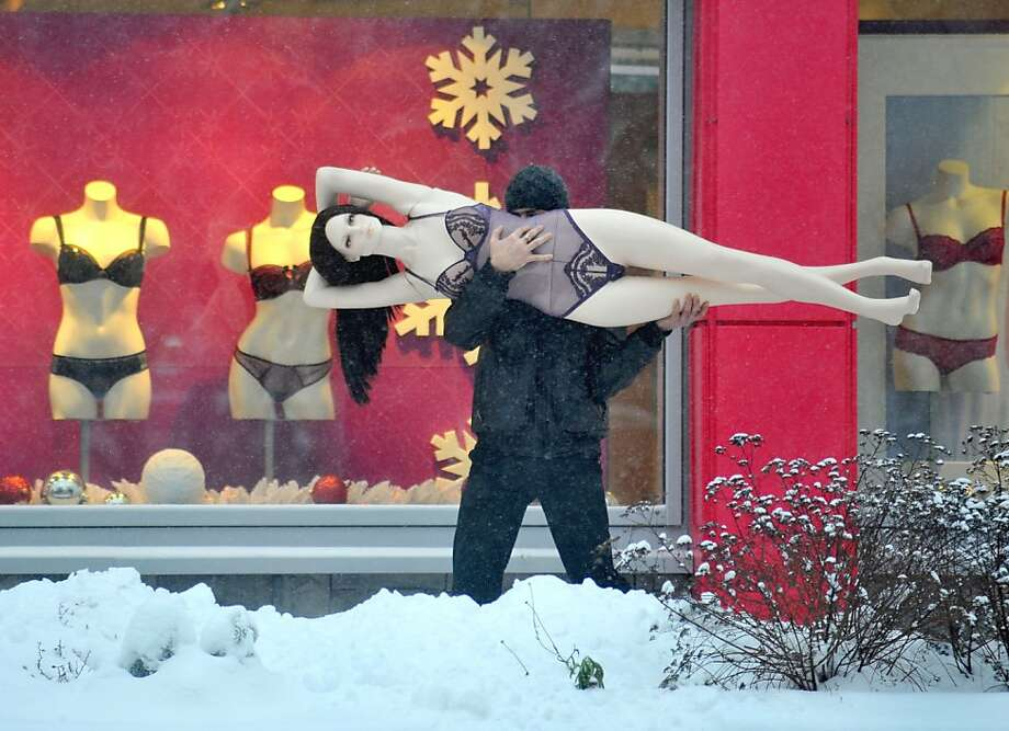 A man carries a mannequin in the Belarus capital Minsk, on December 10, 2012. AFP PHOTO / VIKTOR DRACHEVVIKTOR DRACHEV/AFP/Getty Images Photo: Viktor Drachev, AFP/Getty Images