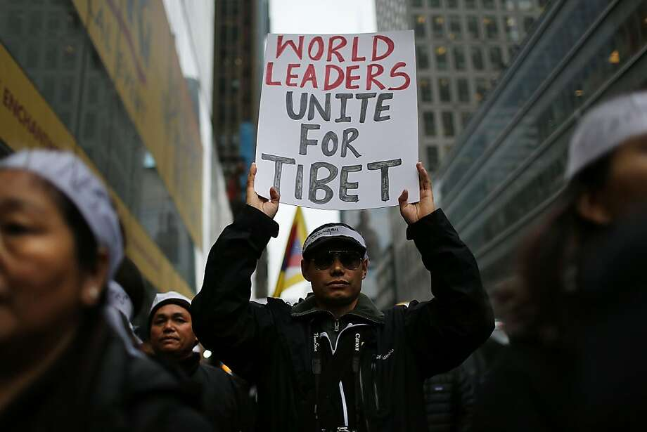 Protestors march down 42nd street to the United Nations General Assembly Building in recognition of International Human Rights Day on December 10, 2012 in New York City. Chinese-occupied Tibet has witnessed over 90 Tibetans self-immolating themselves in protest to China since 2009. Tibetans, their supporters and human rights activists are calling for immediate action by the United Nations and world governments to pressure China to resolve the issue.  (Photo by Spencer Platt/Getty Images) *** BESTPIX *** Photo: Spencer Platt, Getty Images