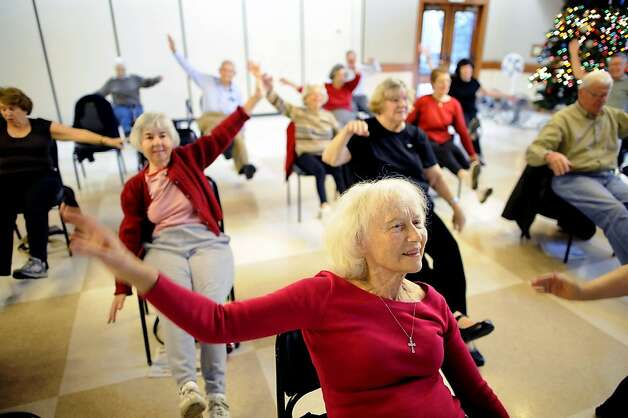 Joan Archibald, 80, works out in Nancy Agronin's San Carlos Sit and Be Fit class. Exercise can help keep bones stronger. Photo: Michael Short, Special To The Chronicle