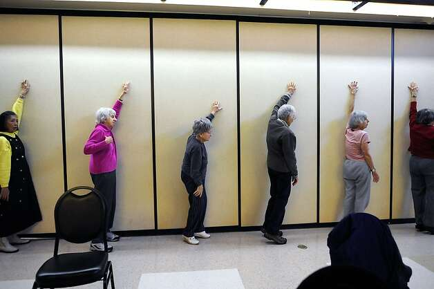 Participants stretch in Agronin's exercise class, which helps seniors maintain their balance and strength. Photo: Michael Short, Special To The Chronicle