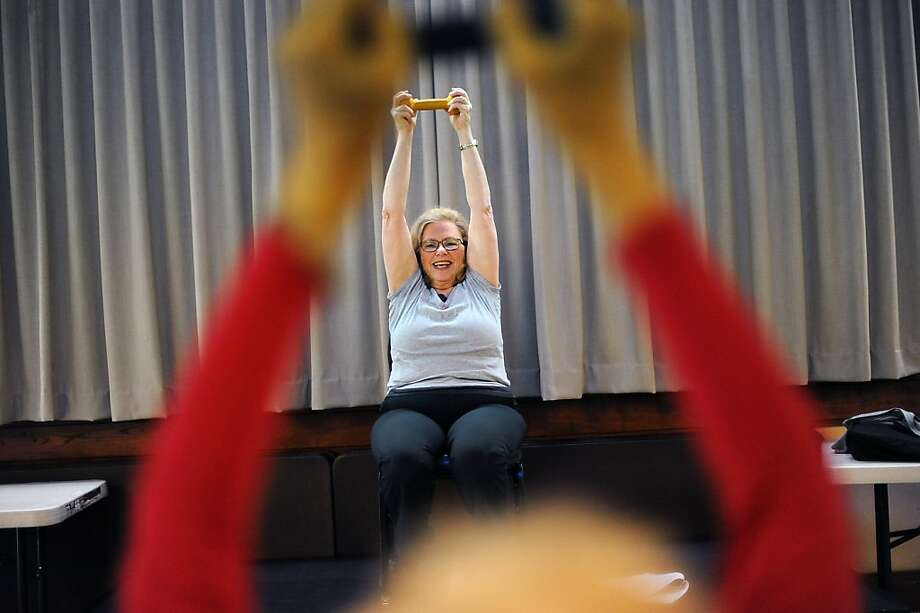 Nancy Agronin, whose osteoporosis is linked to breast cancer treatment years ago, now teaches a Sit and Be Fit class. Photo: Michael Short, Special To The Chronicle