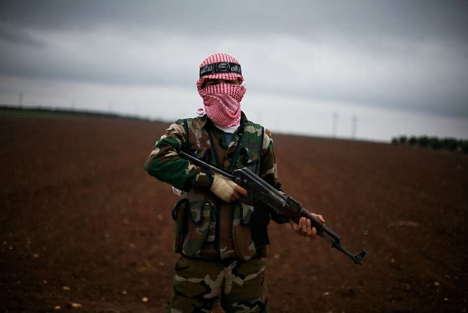 A Free Syrian Army fighter takes position close to a military base, near Azaz, Syria, Monday, Dec. 10, 2012. The gains by rebel forces came as the European Union denounced the Syrian conflict, which activists say has killed more than 40,000 people. (AP Photo/Manu Brabo) Photo: Manu Brabo, Associated Press