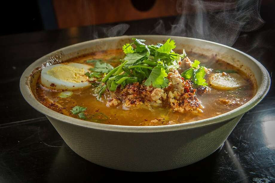 The minced pork spicy noodle soup serves as a great warmer-upper at Coconut Bay Street Cafe in Burlingame. Another standout is the chive cakes, right, traditional glutinous patties packed with the pungent bright green chives. Photo: John Storey, Special To The Chronicle