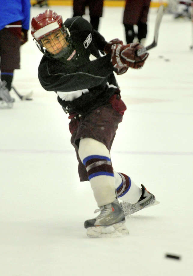 Jordan Warren shoots on goal during the Ice Cats' practice at Danbury Arena on Monday, Dec. 10, 2012. Photo: Jason Rearick / The News-Times