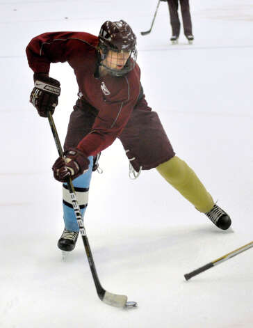 Scott Martin controls the puck during the Ice Cats' practice at Danbury Arena on Monday, Dec. 10, 2012. Photo: Jason Rearick / The News-Times