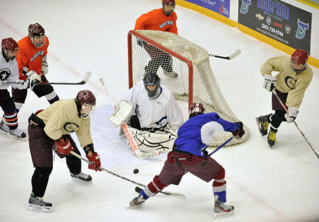 Chris Walker tends the goal during the Ice Cats' practice at Danbury Arena on Monday, Dec. 10, 2012. Photo: Jason Rearick / The News-Times