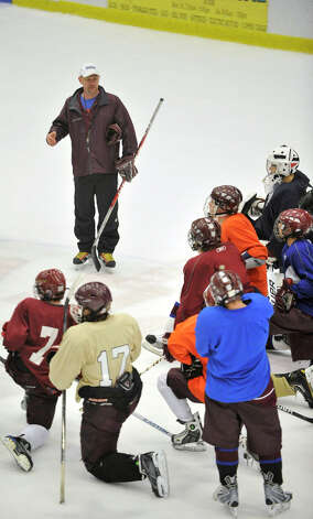 Head coach Rusty Granacker talks to his team during the Ice Cats' practice at Danbury Arena on Monday, Dec. 10, 2012. Photo: Jason Rearick / The News-Times