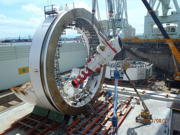 Crews in Japan install the SR 99 tunnel boring machine's screw conveyer on Aug. 27, 2012. Photo: Washington State Department Of Transportation