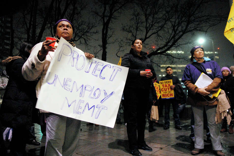 Clara Cator, left, joins protesters as the AFL-CIO, MoveOn.org and the Service Employees International Union organized a series of demonstrations nationwide including one at the Government Center in Stamford, Conn., Dec. 10, 2012. The demonstrations were timed to coincide with federal budget negotiations, demonstrators support increasing taxes on the wealthy and oppose reductions in funding for government benefit programs. Photo: Keelin Daly / Stamford Advocate Riverbend Stamford, CT
