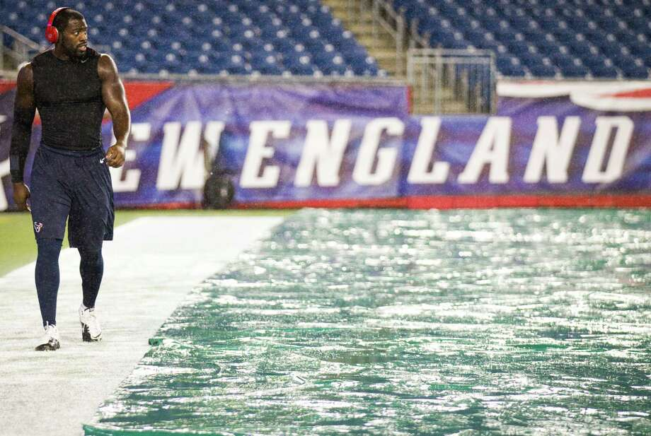 Texans outside linebacker Whitney Mercilus walks along the back of the end zone as rain falls before the Texans game against the New England Patriots in a Monday Night Football game at Gillette Stadium on Monday, Oct. 8, 2012, in Foxborough, Mass. Photo: Brett Coomer, Houston Chronicle / © 2012  Houston Chronicle