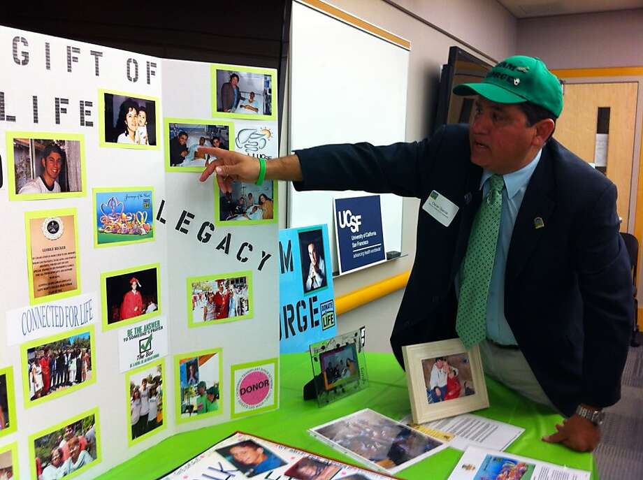 Oscar Garcia points to a picture of George Becker, the young man whose donated liver saved the life of Garcia's son, Alfonso. Photo: Ellen Huet, The Chronicle