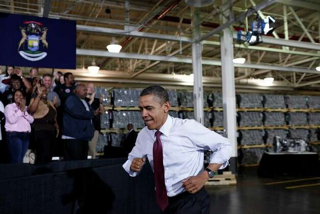 President Barack Obama takes the stage at Daimler Detroit Diesel plant in Redford, Mich. on Monday.  Obama toured the plant and talked about the economy and the looming so-called fiscal cliff. Obama has been in full anti-Republican campaign mode as if the election had never ended. Photo: LUKE SHARRETT, New York Times / NYTNS