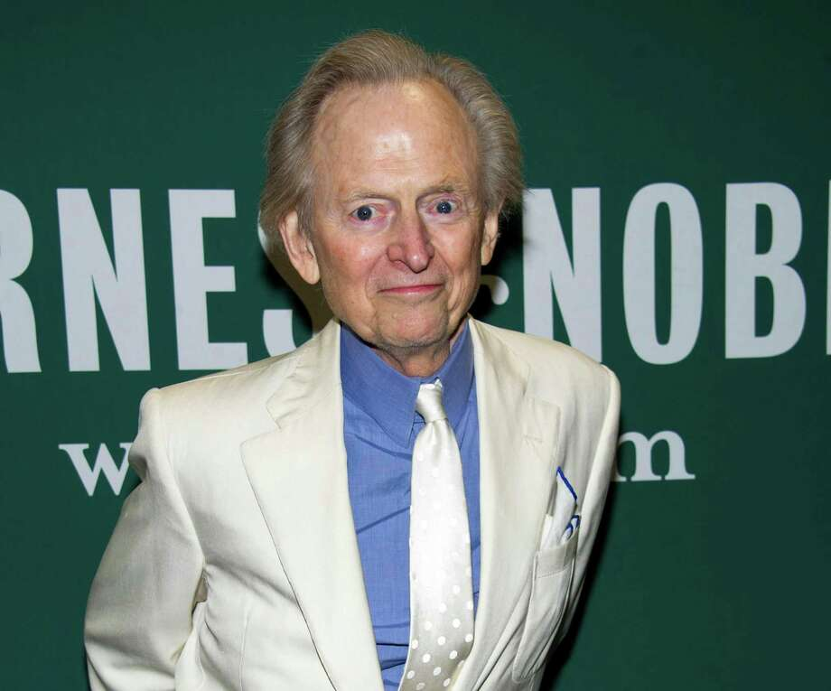 "This October photo shows author Tom Wolfe at a book signing for his novel ""Back to Blood"" at Barnes & Noble in New York. Wolfe's ""Back to Blood"" came out this fall. Photo: Charles Sykes, Associated Press / Invision"