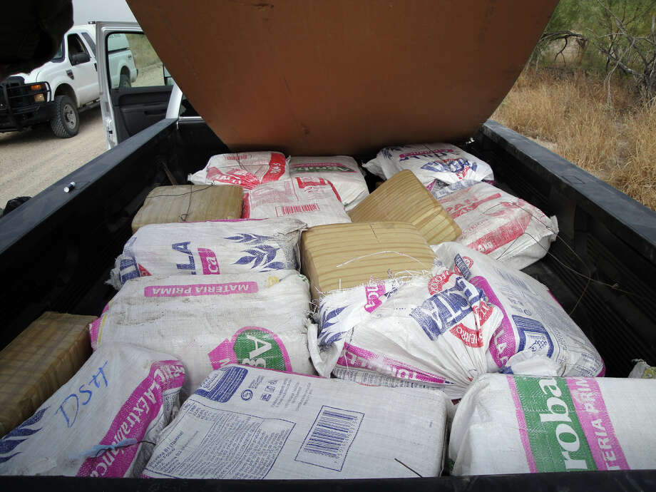 U.S. Border Patrol agents in Eagle Pass found 880 pounds of marijuana stuffed in feed sacks inside of a pickup in one of three drug seizures that took place over the weekend. Together, the busts netted 1,500 pounds, or $1.24 million worth, of drugs. Courtesy photo (U.S. Border Patrol)
