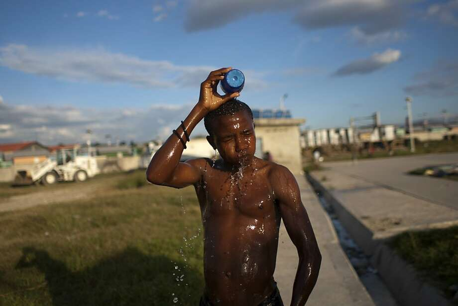 A man bathes at a camp set up for people displaced by the 2010 earthquake in Port-au-Prince, Haiti, Monday, Dec. 10,  2012. (AP Photo/Dieu Nalio Chery) Photo: Dieu Nalio Chery, Associated Press
