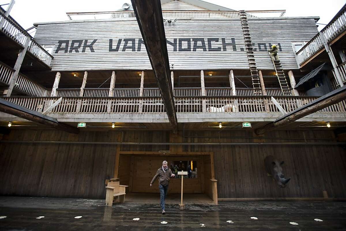 Johan Huibers, center, shows journalists the inside of the full scale replica of Noah's Ark in Dordrecht, Netherlands, Monday Dec. 10, 2012. The Ark has opened its doors in the Netherlands after receiving permission to receive up to 3,000 visitors per day. For those who don't know or remember the Biblical story, God ordered Noah to build a boat massive enough to save animals and humanity while God destroyed the rest of the earth in an enormous flood. Johan's incredibly detailed interpretation measures in at a massive 130 meters (427 feet) long, 29 meters (95 feet) across and 23 meters (75 feet) high. (AP Photo/Peter Dejong)