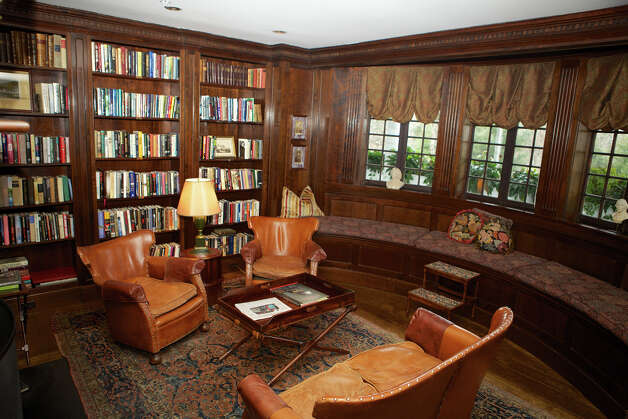The library in the Mayflower House features a fireplace. Photo: Trish Haldin / The News-Times Freelance