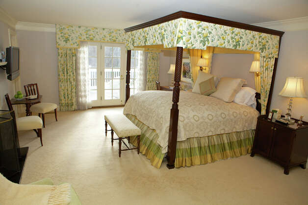 Located on the second floor of the Mayflower House, this room features an open balcony with a view of the Shakespeare Garden. There is also a king-size canopy bed, gas fireplace and sitting area. The bathroom includes a tub and separate walk-in shower. Photo: Trish Haldin / The News-Times Freelance