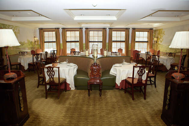 In the Main Dining Room you can experience a memorable meal in an elegant, yet relaxed atmosphere.  The Mayflower Inn & Spa is located at: 118 Woodbury Road Route 47 Washington, CT 06793  Telephone: 860-868-9466 Photo: Trish Haldin / The News-Times Freelance