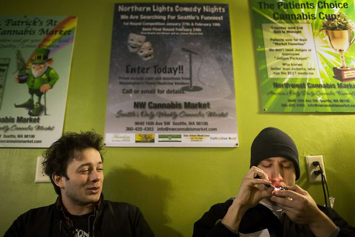 Medical marijuana patients Brett Skaret, 20, left, and Joe Engelhardt, 22, enjoy the freedom of a smoking room with other smokers Saturday, December 8, 2012, at the NW Cannabis Market in Seattle, Washington. The pair are vehemently opposed to the recent passage of I-502.