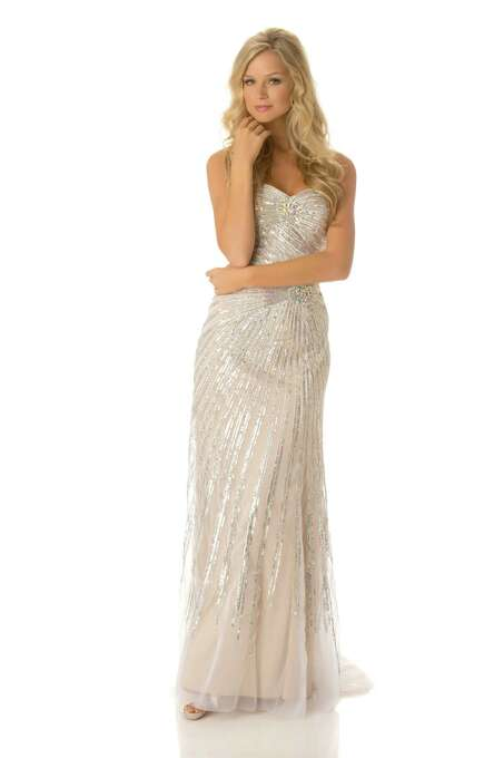 Miss Australia 2012, Renae Ayris, poses in her evening gown. The Aussies have become pageant-crazy since Jennifer Hawkins carried off the title in Ecuador in 1994; Hawkins is now an iconic and wealthy model in Australia and the country has produced four straight top-10 finalists coming into this year's pageant, including a second runner-up (Jesinta Campbell) and a third runner-up (Rachael Finch). Both are now TV personalities Down Under. Photo: Matt Brown, Miss Universe Organization / Miss Universe Organization