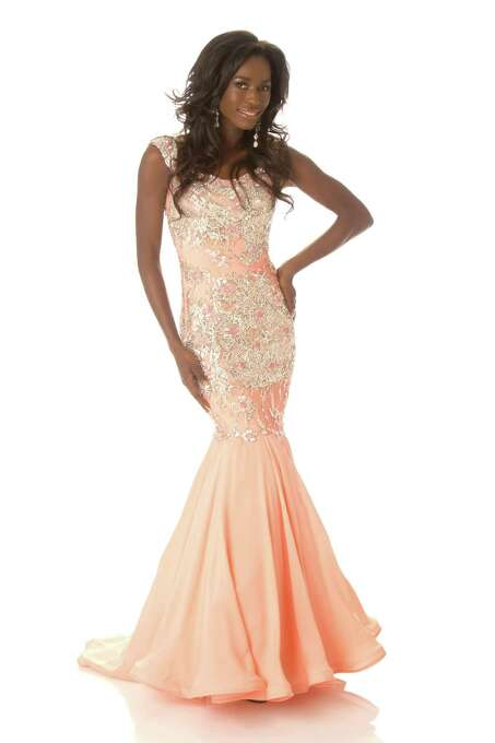 Miss Canada 2012, Yamoah Adwoa, poses in her evening gown. Adwoa was actually her country's first runner-up, but was pressed into service just the week before her arrival in Las Vegas when the national winner, Sahar Biniaz of Vancouver, slipped on a hiking trail and badly injured an ankle. Photo: Matt Brown, Miss Universe Organization / Miss Universe Organization