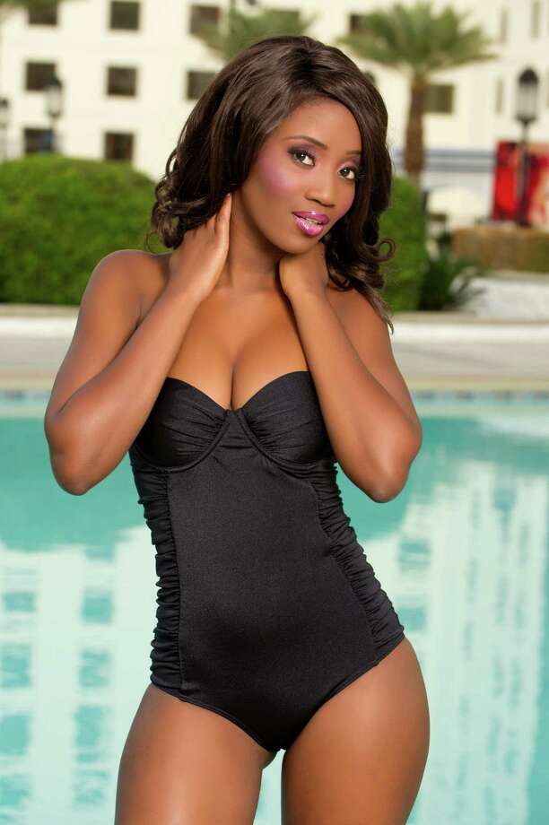 Miss Botswana 2012, Sheillah Molelekwa, poses for photos in swimwear by Kooey Australia. Photo: Darren Decker, Miss Universe Organization / Miss Universe Organization