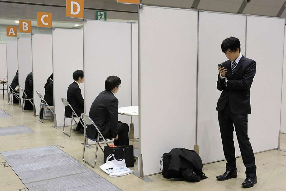 University students talk to job counselors, left, at a job fair hosted by Mynavi Corp. in Tokyo, Japan, on Saturday, Dec. 8, 2012. In Japan, many students accept job offers from large companies six months before graduating and may stay with the same employer until retirement, said Yoshihide Suzuki, an administrative director at the career center at Waseda University. Photographer: Akio Kon/Bloomberg Photo: Akio Kon, Bloomberg