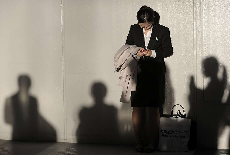 An university student, uses her smartphone at a job fair hosted by Mynavi Corp. in Tokyo, Japan, on Saturday, Dec. 8, 2012. In Japan, many students accept job offers from large companies six months before graduating and may stay with the same employer until retirement, said Yoshihide Suzuki, an administrative director at the career center at Waseda University. Photographer: Akio Kon/Bloomberg Photo: Akio Kon, Bloomberg